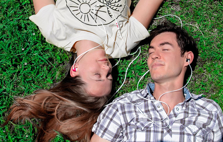 Couple sharing loveBuds two person earphones headphones earbuds